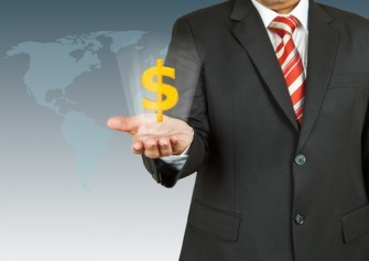 Dollar Symbol In Businessmans Hand